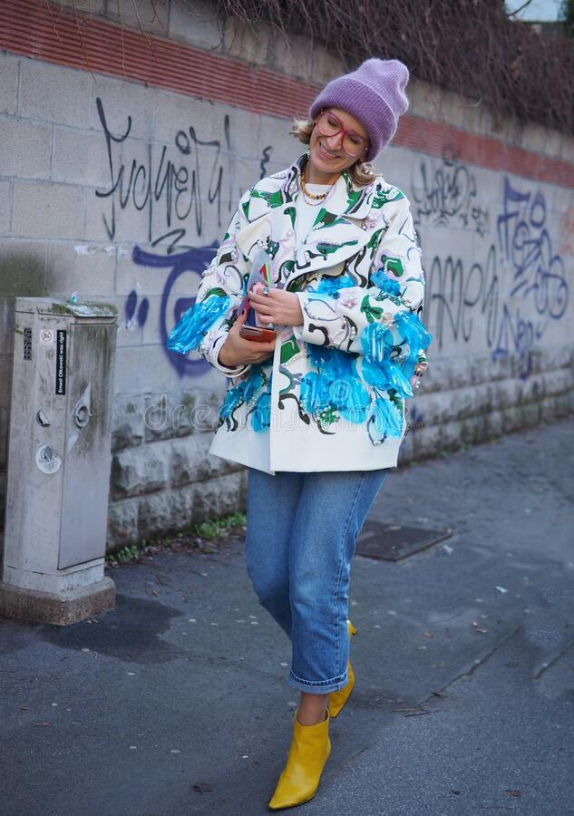 MILAN, Italy: 12 January 2020:  Fashion blogger street style outfit royalty free stock image