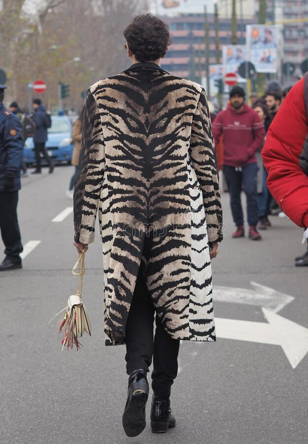 MILAN, Italy: 14 January 2020:  Fashion blogger street style outfit royalty free stock image
