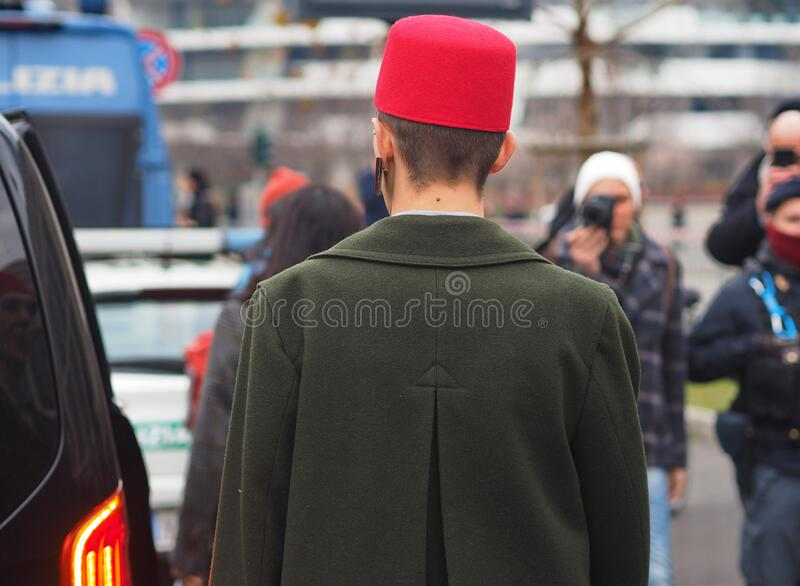 MILAN, Italy: 14 January 2020:  Fashion blogger street style outfit royalty free stock photo