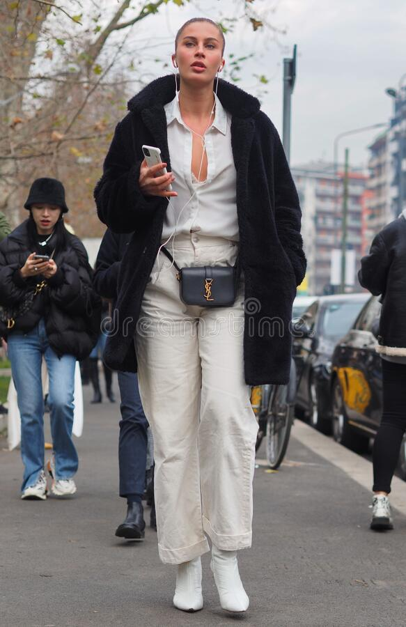 MILAN, Italy: 14 January 2020:  Fashion blogger street style outfit stock photo