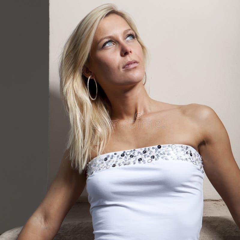 Fashion blond girl in white shirt, blue eyes stock photo