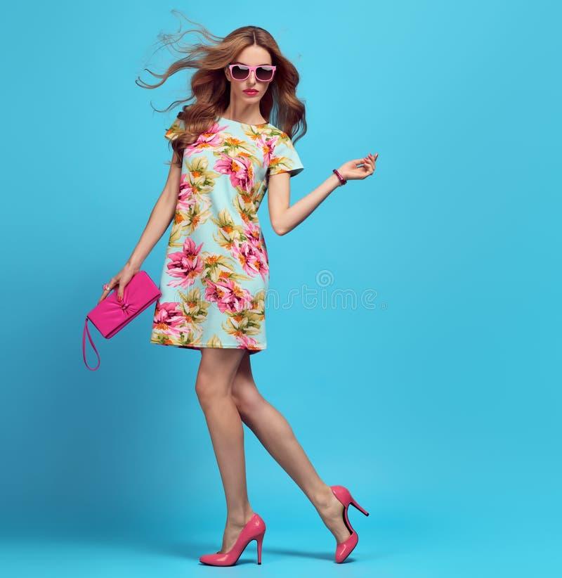 Free Fashion. Blond Woman In Fashion Pose. Pink Heels Royalty Free Stock Photo - 105264385