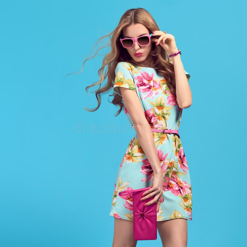 Fashion Blond woman, Stylish Summer Outfit. Gorgeous Fashion Blond woman, Trendy Sunglasses. Young female model in Stylish Summer Outfit Posing in Studio royalty free stock images
