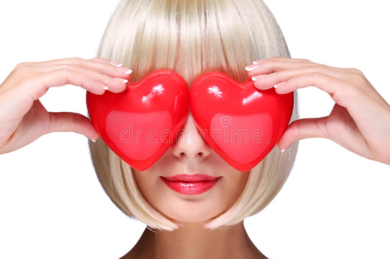 Fashion Blonde Girl with Red Hearts in Valentines Day. Glamorous. Young Woman with Short Bob Hairstyle isolated on white. Love Concept royalty free stock photo