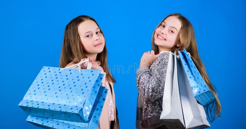 Fashion boutique kids. Shopping of her dreams. Happy children in shop with bags. Shopping is best therapy. Shopping day royalty free stock photos