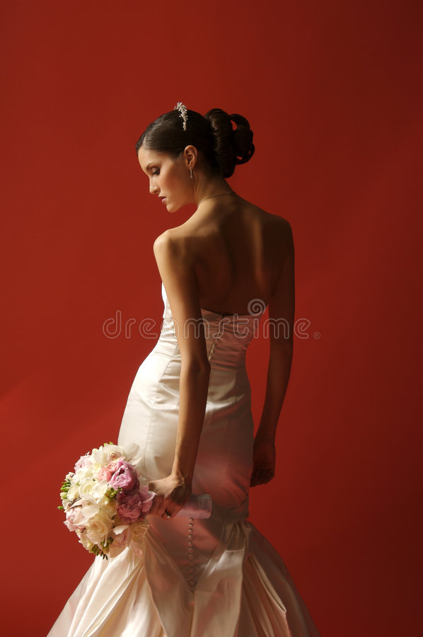 Fashion Bride on Red background royalty free stock image