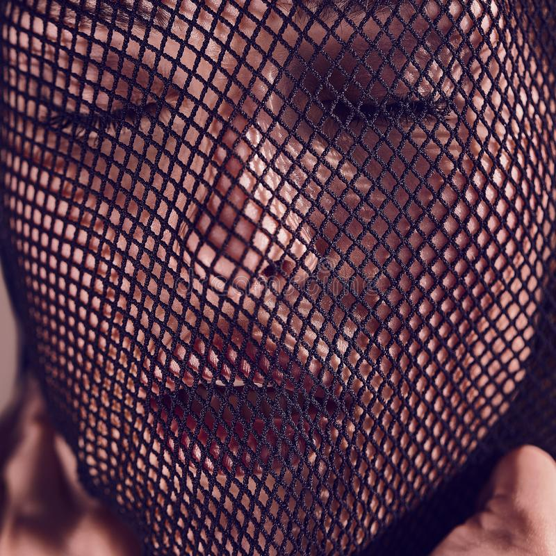 Beautiful sensual woman in a black veil on her face. royalty free stock photos
