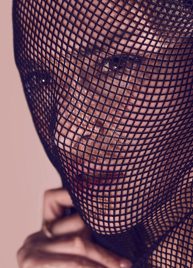 Beautiful sensual woman in a black veil on her face. royalty free stock photography