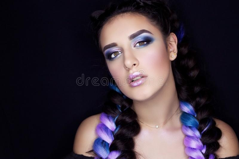 Professional makeup for brunette with colored hair royalty free stock photo