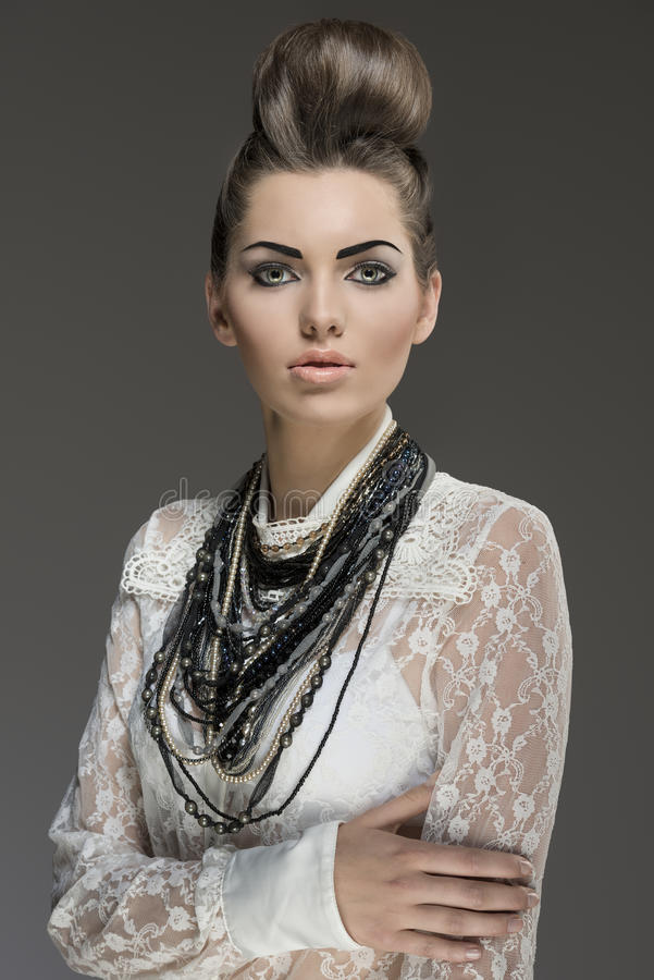 Fashion brunette with necklaces royalty free stock image