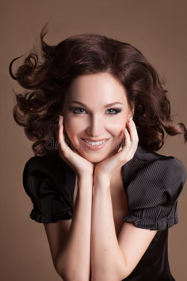 Fashion brunette woman with brown curly hair girl with perfect skin and makeup. Beauty Model retro stock photos