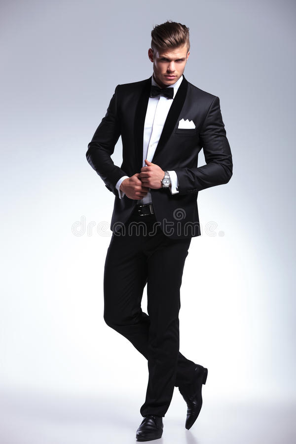 Fashion business man with hands on jacket stock photos