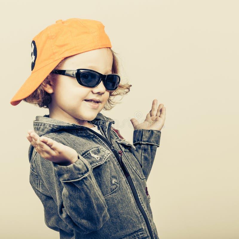 Fashion child. Happy boy model. stock photo