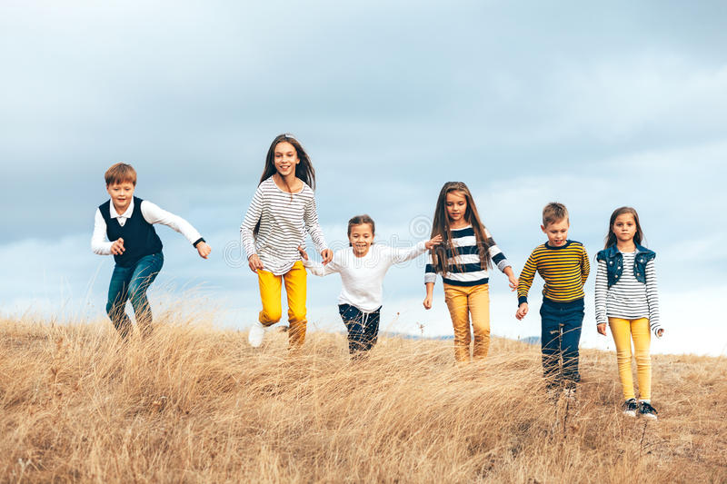 Fashion children in autumn field royalty free stock photography