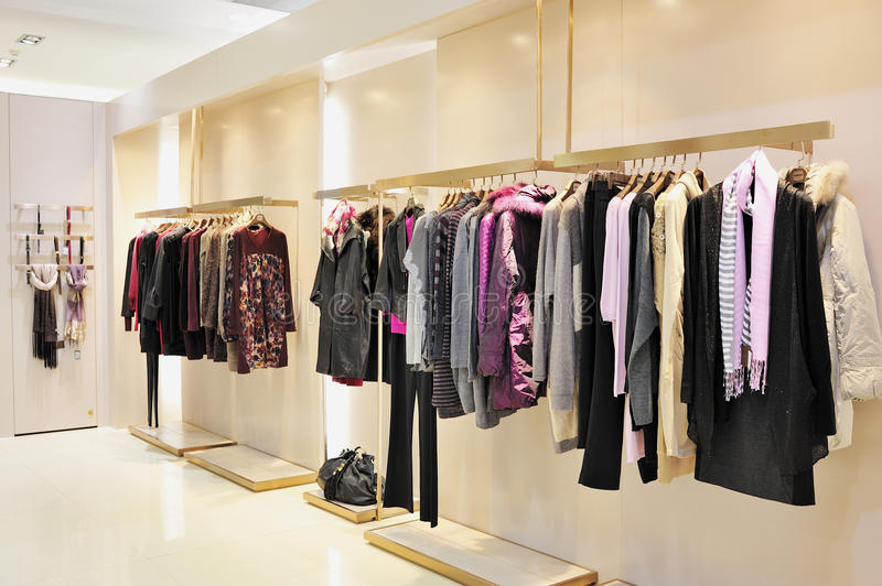 Fashion clothes. Luxury fashion clothes in display for sale in a shop royalty free stock image
