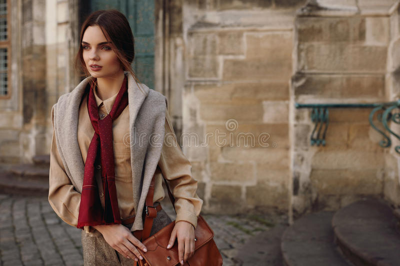 Fashion Clothes. Beautiful Woman In Fashionable Clothing Outdoor. Fashion Clothes. Beautiful Woman Wearing High Fashionable Spring, Fall Clothing ( Shirt, Scarf royalty free stock photography