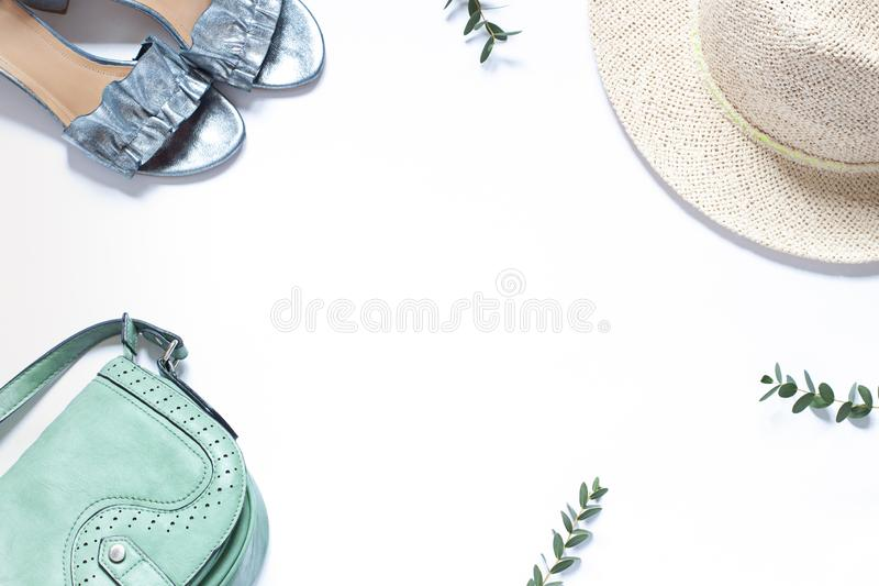 Fashion clothes concept frame with a straw hat on the white background. top view. stock photo