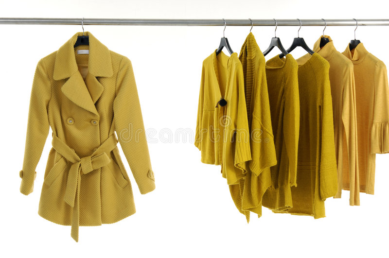 Fashion clothing. Designer fashion clothing hanging as display stock photo