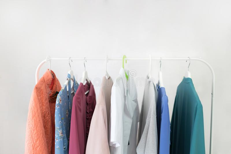 Fashion clothing on hangers at the showroom. Small business. royalty free stock photography