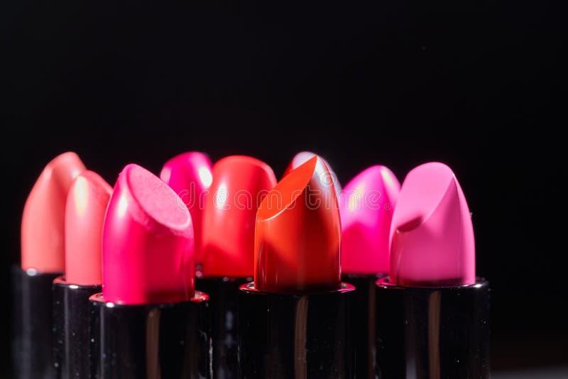 Fashion Colorful Lipsticks over black background. Lipsticks closeup royalty free stock photography