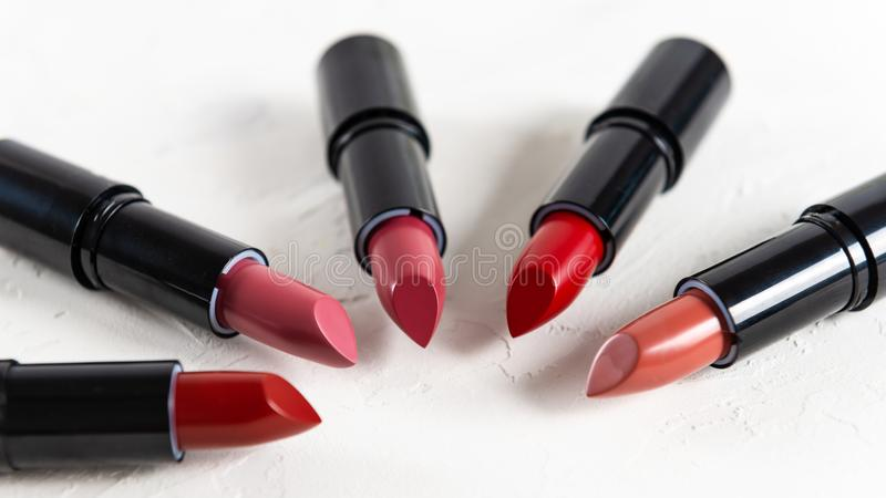 Fashion Colorful Lipsticks over white background. Lipstick tints palette, Professional Makeup and Beauty. Beautiful Make-up stock images