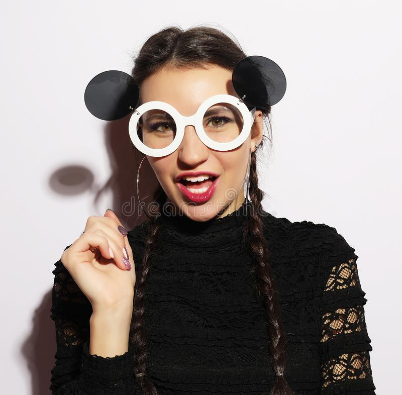 Fashion concept. Beauty surprised fashion model girl wearing big sunglasses. Young girl. Makeup. stock photos