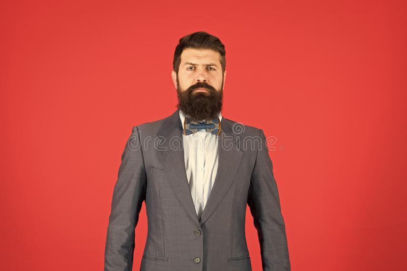 Fashion concept. Businessman or host fashionable outfit red background. Formal outfit. Confident posture. Man bearded royalty free stock image