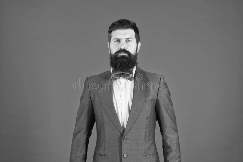 Fashion concept. Businessman or host fashionable outfit red background. Formal outfit. Confident posture. Man bearded stock photography