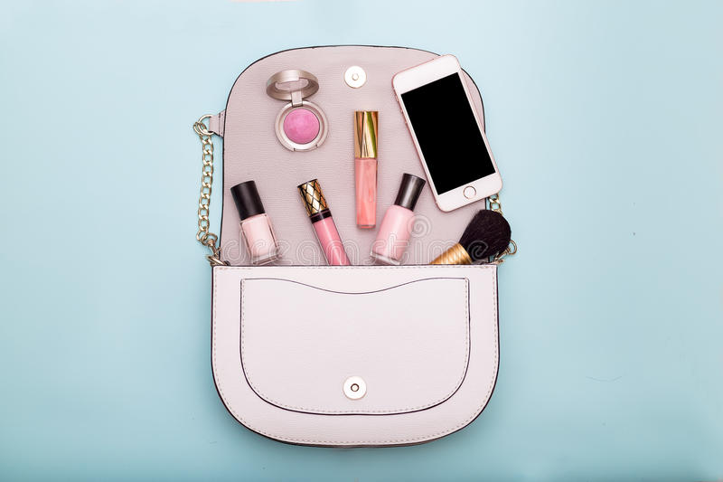 Fashion Cosmetic Makeup.Women`s accessories in a bag. Top view royalty free stock photo