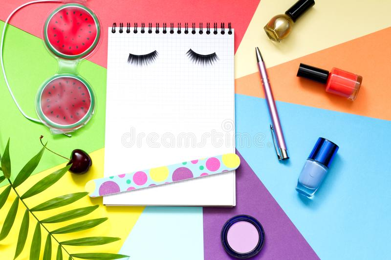 Fashion cosmetics beauty abstract lifestyle blog background with notebook and accessories. Closeup stock photo
