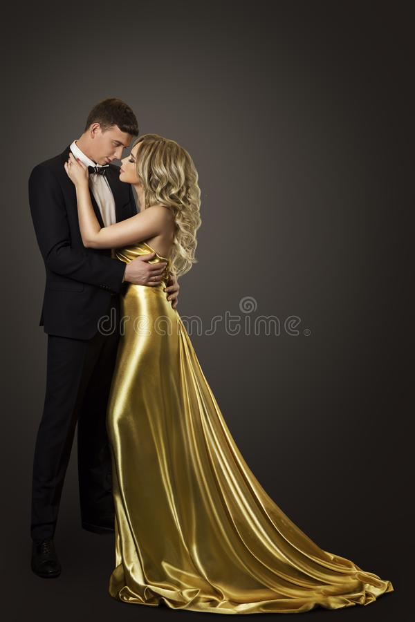 Fashion Couple Beauty Portrait, Kissing Man and Woman, Gold Dress royalty free stock photography