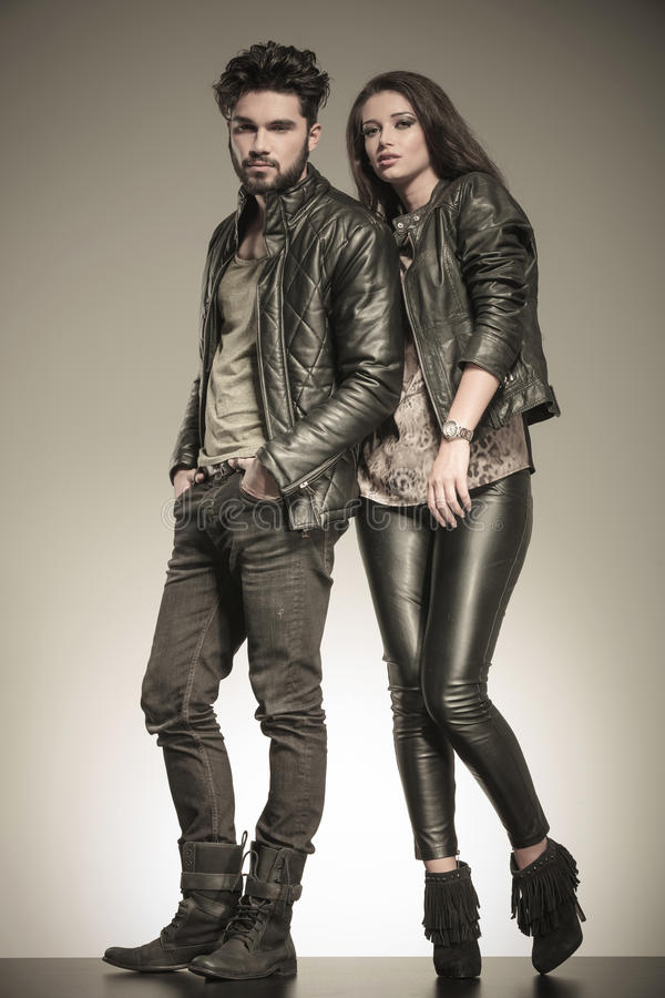 Fashion couple in casual leather jackets posing stock image