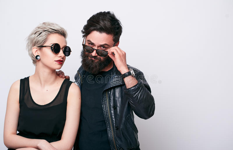 Fashion couple in leather clothes posing in studio stock image
