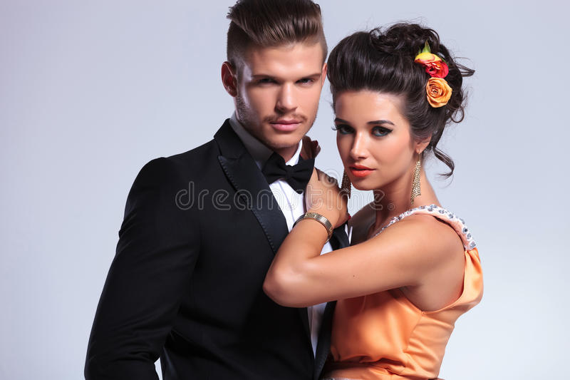 Fashion couple looking at you stock images