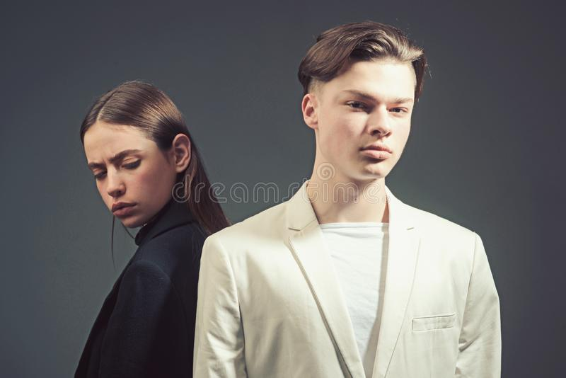 Fashion couple in love. Beauty and fashion. Man and woman. Hair style and skincare. Friendship relations. Family bonds. Bad date. black and white - opposites royalty free stock image