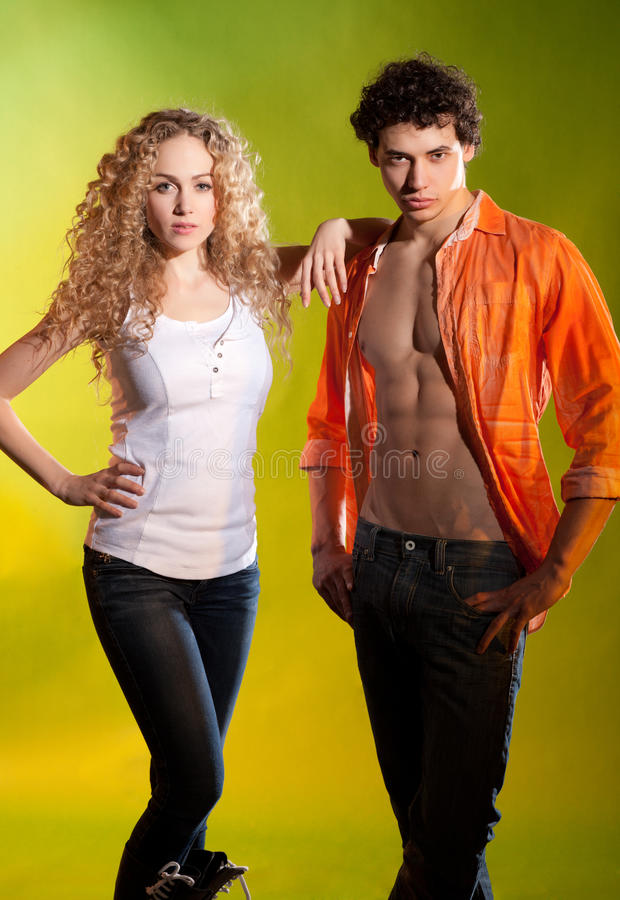 Fashion couple posing in studio stock images