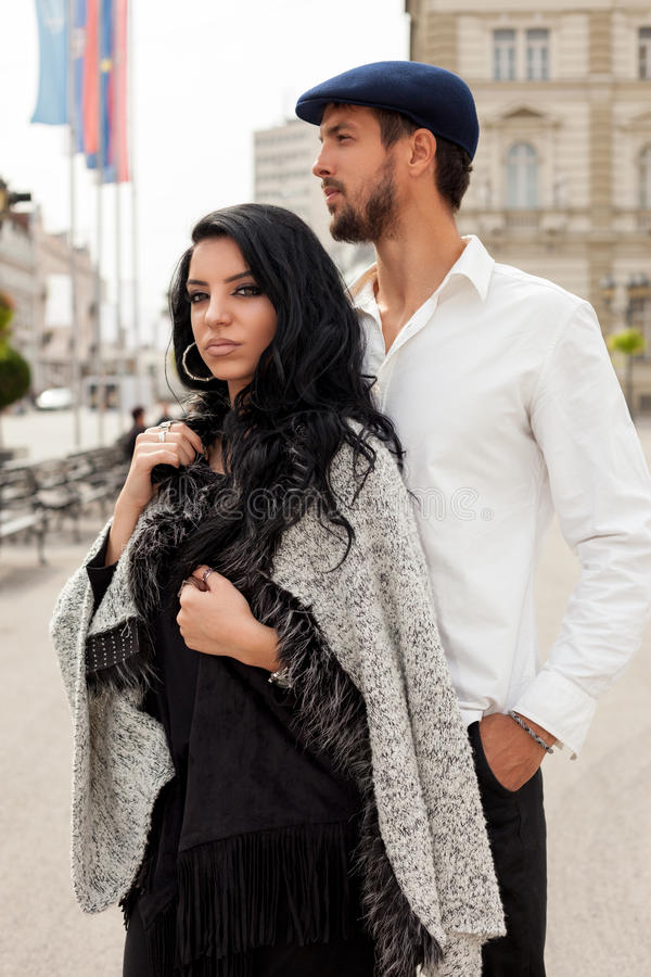 Fashion couple posing together royalty free stock photo
