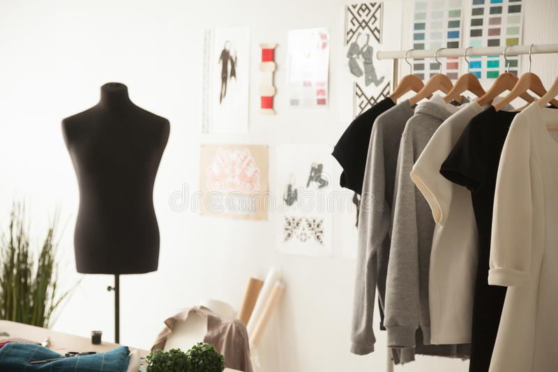 Fashion design cozy studio interior with dummy, dressmaking and. Fashion creative design studio cozy interior concept with mannequin dummy and exclusive unique royalty free stock photography