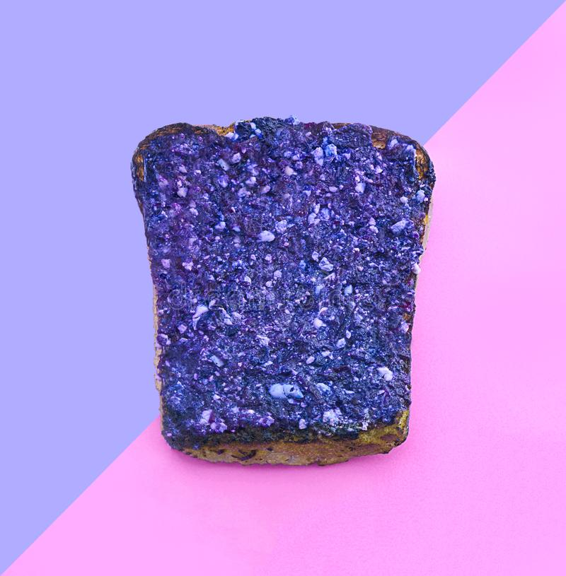 Fashion creative ultra violet toast on pink paper background. Trendy minimal pop art style. Conceptual idea with bread. royalty free stock photo
