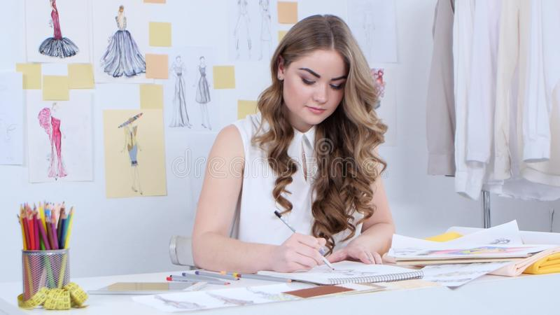 Fashion Designer Draws Sketches For A New Collection And Looks At The Computer Stock Footage Video Of Education Clothing 90336532