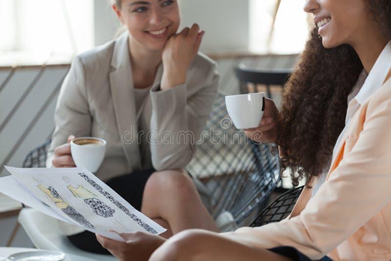 Fashion designer drinking coffee stock images