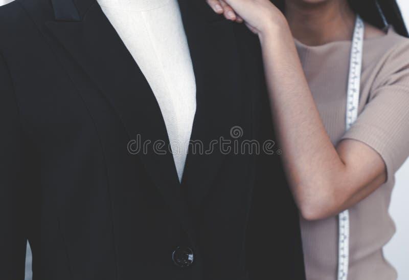 Fashion Designer hand measuring jacket length royalty free stock images