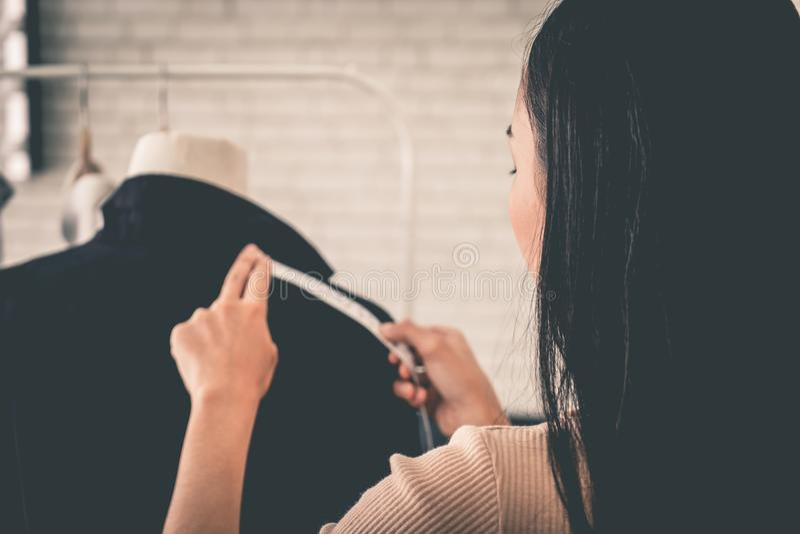 Fashion Designer hand measuring jacket shoulder royalty free stock photos
