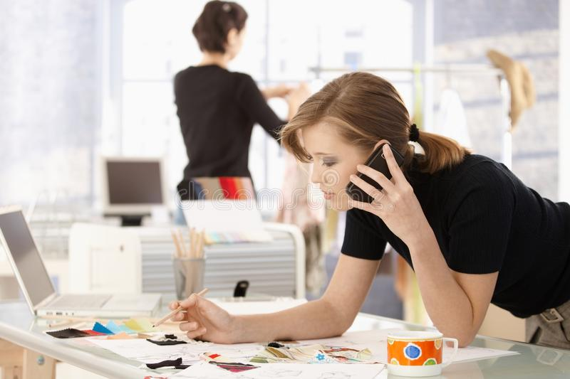 Fashion designer in office stock photos