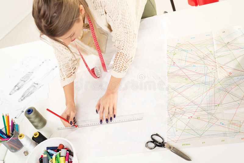 Fashion Designer With Sewing Pattern royalty free stock image