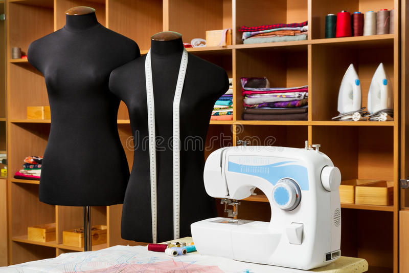 Fashion designer studio with dressmakers equipment stock