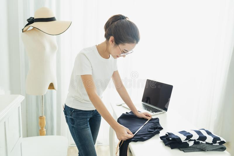 Fashion designer stylish showroom concept, Young asian girl is freelancer with her private business at home office, Working. With laptop,Online marketing royalty free stock photo