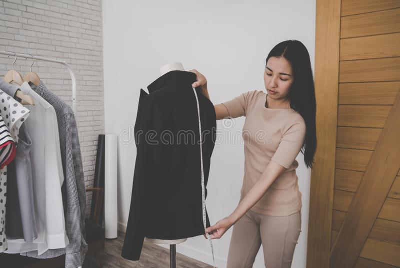 Fashion designer tailor is measuring office suit jacket royalty free stock image