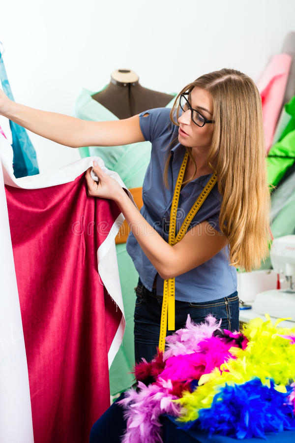 Download Fashion Designer Or Tailor Working In Studio Royalty Free Stock Image - Image: 33399576