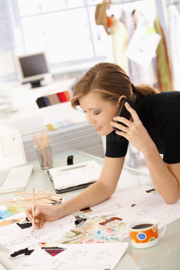 Fashion designer at work stock images